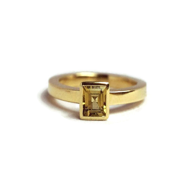 Handmade yellow gold ring with gemstone