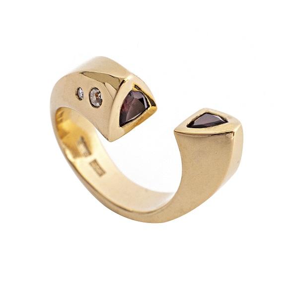Gold tork garnet ring